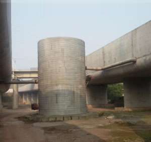 Corrugated metal water storage tank on TongHe express way
