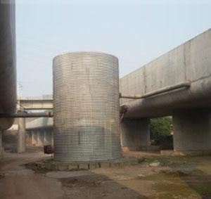 Corrugated metal water storage tank on TongHe express way